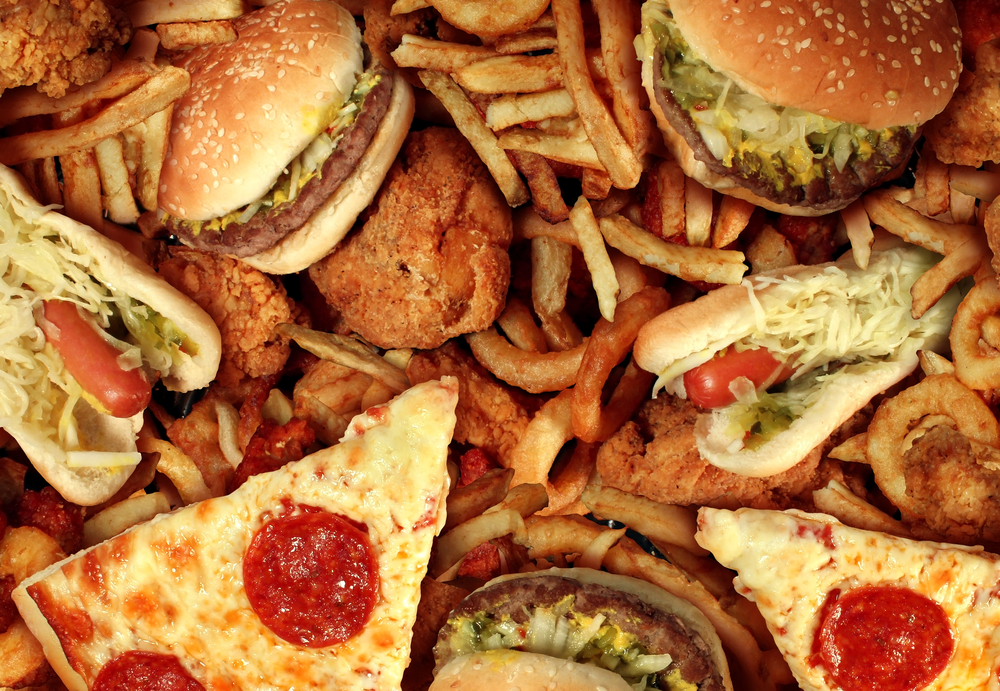Greasy foods including pizza, hamburgers, fries, hot dogs, and onion rings