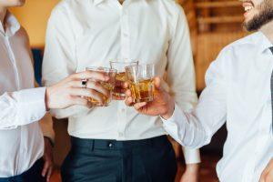 groomsmen toasting drinks