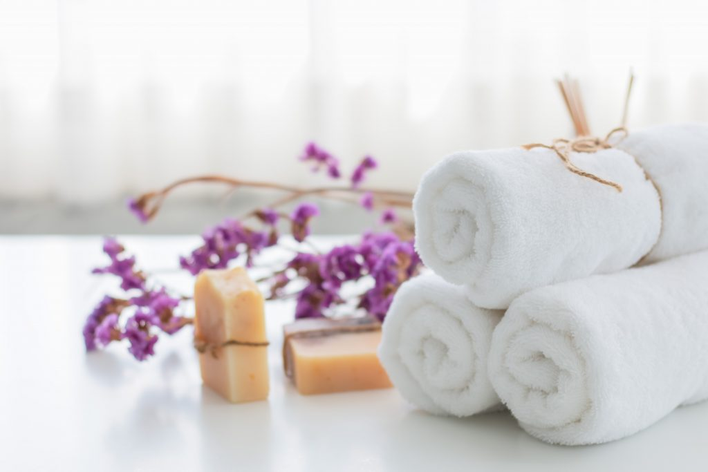 Photo of Towels and flowers on table