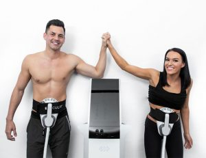 Two people using Emsculpt