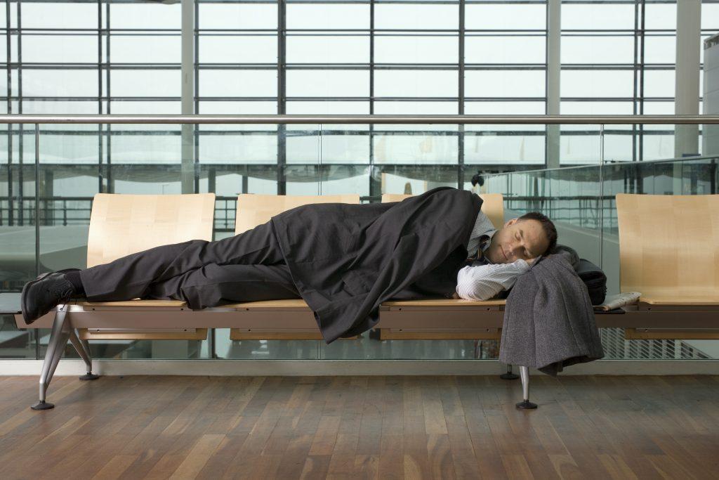 Man Sleeping with Jet Lag